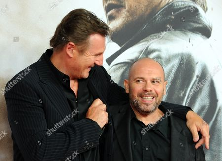 Irish Actor Liam Neeson (l) and French Director Olivier Megaton (r) Pose at the German Premiere of Their Film 'Taken 2' in Berlin Germany 11 September 2012 Germany Berlin