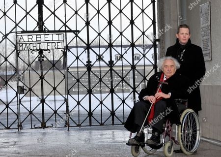 Concentration Camp Survivor Max Mannheimer (in the Wheelchair) and a Helper Stand in Front of the Entrance of the Concentration Camp Memorial Site Dachau Near Munich Germany 20 February 2013 Czech Prime Minister Necas who is on an Official Visit to Bavaria Visited the Memorial Site Dachau on 20 February Germany Munich
