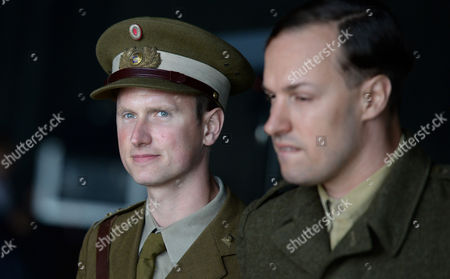 The Image Made Available on 12 August 2014 Shows Danish Actor Mikkel Boe Folsgaard (l) in the Role of a Danish Captain Posing at the Set of the German-danish Film Production 'Under the Sand' in Leck Germany 11 August 2014 the Film Tells the Story of German Prisoners of War who Were Forced to Clear Mines Off the Danish Coast After World War Ii Germany Leck