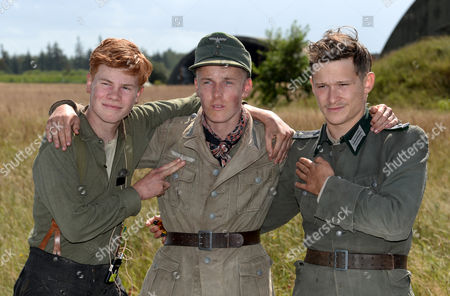 The Image Made Available on 12 August 2014 Shows German Actors Leon Seidel (l-r) Louis Hofmann and Swiss Actor Joel Basman Posing at the Set of the German-danish Film Production 'Under the Sand' in Leck Germany 11 August 2014 the Film Tells the Story of German Prisoners of War who Were Forced to Clear Mines Off the Danish Coast After World War Ii Germany Leck