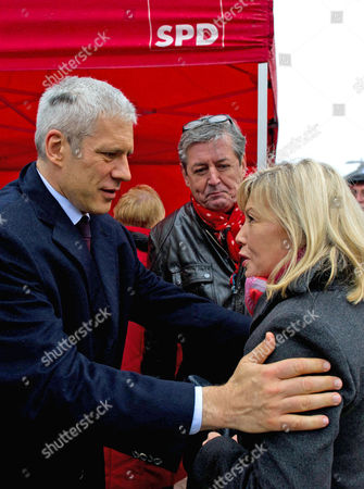 Former Serbian President Boris Tadic (l) Greets Doris Schroeder-koepf (r) Wife of Former German Chancellor Gerhard Schroeder at Kroepcke Square in Hanover Germany 05 January 2013 where the German Lower-saxony's State Social Democratic Party Spd was Campaigning For the Upcoming Regional State Elections to Be Held on 20 January Germany Hanover