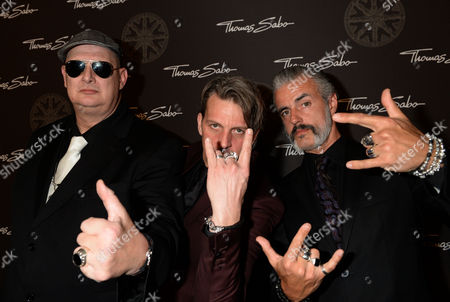 The Member of Belgian Rock Band Triggerfinger (l-r) Paul Van Bruystegem Mario Goossens and Ruben Block Pose For Photographs As She Attends the Thomas Sabo Karma Night Event at Postpalast in Munich Germany 15 February 2014 Germany Munich