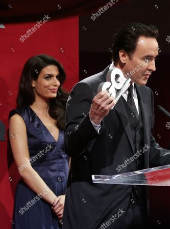 Us Actor John Cusack (r) Speaks After Receiving the Award in the Category 'Film International' From Greek Actress Tonia Sotiropoulou (l) During the 'Gq Man of the Year 2012' Award Ceremony at the Komische Oper in Berlin Germany 26 October 2012 the Men's Magazine Gq Presents the Award to Personalities From the Show and Music Businesses As Well As Society Sport Politics Culture and Fashion Germany Berlin