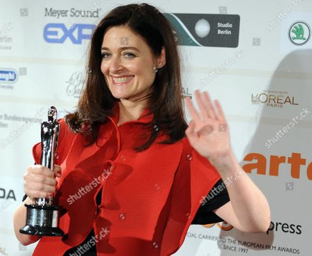 Stock Photo of Lars Von Trier's Wife Bente Froge Poses with the European Film 2011 Award For the His Movie 'Melancholia' During the 24th European Film Awards at the Tempordrom in Berlin Germany 03 December 2011 Germany Berlin