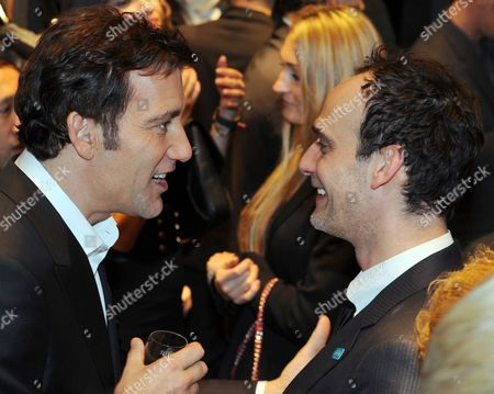 British Actor Clive Owen (l) and Swiss Actor Anatole Taubman Attend the Giorgio Armani Cocktail Party in the New Boutique at the Kurfuerstendamm in Berlin Germany 14 February 2012 Germany Berlin