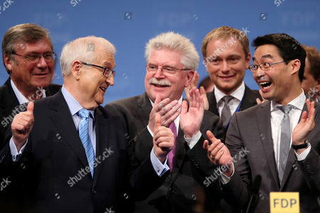 (l-r) Chairman of the Friedrich Naumann Foundation For Freedom Wolfgang Gerhardt the Leading Candidate For the Federal Election Rainer Brüderle Bavaria's Economics Minister Martin Zeil the Deputy National Chairman Christian Lindner and the National Chairman Philipp Roesler Applaud During an Extraordinary Party Meeting of the Fdp in Nuremberg Germany 05 May 2013 Germany Nuremberg
