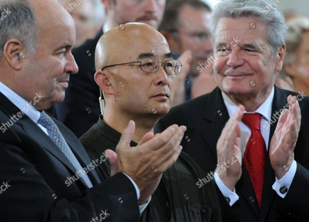 Stock Image of Chinese Writer Liao Yiwu (c) is Applauded After Winning the Peace Prize of the German Book Trade by German President Joachim Gauck (r) and Gottfried Honnefelder Director of the German Publishers and Booksellers Association in Frankfurt Main Germany 14 October 2012 the Author Fled China and Lives in Exile in Germany the Peace Prize Has Been Awarded Since 1950 at the End of the Frankfurt Book Fair and is Endowed with 25 000 Euros Germany Frankfurt Main