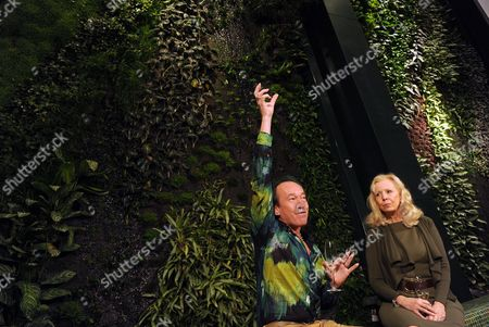 Stock Photo of The French Botanist Patrick Blanc (l) and Catherine Von Fuerstenberg-dussmann Sit in Front of a Vertical Garden Consisting of More Than 6 600 Tropical Plants in Berlin Germany 17 January 2012 the So-called 'Mur Vegetal' Seized 18 by 15 Meters is Presented at the Dussmann Department Store in Berlin Germany Berlin