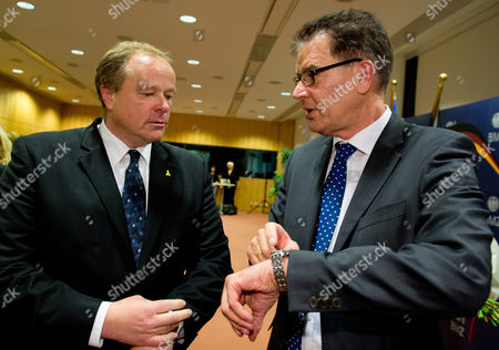 The New German Minister For Economic Cooperation and Development Gerd Mueller (r) and His Predecessor Dirk Niebel (l) Talk to Each Other During the Handing-over of Office in the Ministry in Berlin Germany 17 December 2013 Germany Berlin