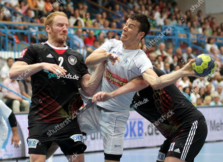 Germany's Stefan Kneer (l) and Kevin Schmidt (r) in Action Against Israel's Avishay Smoler (c) During the European Handball Championship Qualification Match Between Germany and Israel at Frankenstolz Arena in Aschaffenburg Germany 15 June 2013 Germany Aschaffenburg