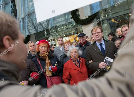 (l-r) Actress and Singer Zazie De Paris Holocaust Survivor Margot Friedlaender and Berlin's State Secretary of Culture Andre Schmitz Listen to Speaker During an Event to Commemorate 'Kristallnacht' ('night of Broken Glass') the 08 November 1938 Night Outbreak of Nazi Violence Against Jewish Citizens and Synagogues in Berlin Germany 09 November 2013 with a Walkabout in Berlin Local Celebrities and Officials Commemorated Jewish Nazi Victims Germany Berlin