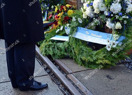Israeli Ambassador to Germany Yakov Hadas-handelsman Stands at a Wreath Laid on the Eve of the 75th Anniversary of Reichskristallnacht (night of the Broken Glass) at Gleis 17 (lit Track 17) Memorial in Berlin Germany 08 November 2013 During Wwii Gleis 17 was Used by Nazi Regime As a Hub to Deport Jews to Concentration and Extinction Camps After an Anti-semitic Rabble-rousing Speech by Nazi Propaganda Minister Joseph Goebbels Assault Troops of the Ssáand Sa the Paramilitary Organizations of Hitler's Ruling Nsdap on 09 and 10 November 1938 Burnt Down 267 Synagogs Destroyed the Windows of 7 500 Jewish Shops Vandalized Jewish Cemeteries and Battered People Splintered Windows and Glass Splinters on the Streets Gave the Inspiration For the Downplaying Labelling of the Pogrom As 'Night of the Broken Glass' 91 People Died 20 000 Were Detained Germany Berlin