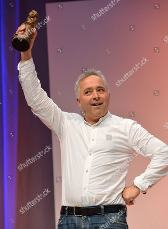 British Author Frank Cottrell Boyce Cheers After Receiving the German Youth Literature Prize 2013 at the Frankfurt Book Fair in Frankfurt Main Germany 11 October 2013 He Won the Prize in the Children's Book Category with the Book 'The Unforgotten Coat' Germany Frankfurt Main