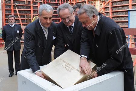 (l-r) Bavarian Minister of Education and Cultural Affairs Ludwig Spaenle the Mayor of Munich Christian Ude and Federal Commissioner For Culture and Media Bernd Naumann Lay the First Stone of the Documentation Centre For the History of National Socialism in Munich Germany 09 March 2012 More Than 65 Years After the End of the Second World War the Documentation Centre Shall Be Opened in 2014 Germany Munich