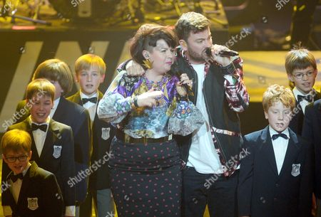 Stock Picture of German Rapper Marteria (c-r) and Singer Miss Platnum (c-l) Perform During the 23rd Echoámusic Awards Ceremony in Berlin Germany 27ámarch 2014 the Awards Are Presented For Outstanding Achievement in the Music Industry Germany Berlin