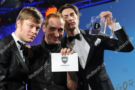 Musicians Gustaf Erik Noren (l) and Bjoern Hans-erik Dixgard (r) of Swedish Band Mando Diao Pose For Photos After Being Awarded with the Prize International Performer by Paul Van Dyk (c) During the Awarding Ceremonies of Mediaprize 'Musikexpress Style Award 2011' Late 08 November 2011 in Berlin Germany the Magazin Musikexpress Honors People and Fashion Labels Since 2005 with an Annual Award Germany Berlin