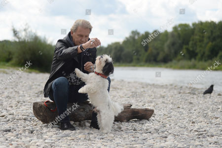 A Picture Made Available 21 September 2013 Shows Irish Musician Johnny Logan Posing For the Photographer with His Dog Balu at the Isar River in Munich Germany 11 September 2013 Logan's New Album 'The Irish Soul - the Irish Connection 2' Will Be Released on 11 October Germany Munich