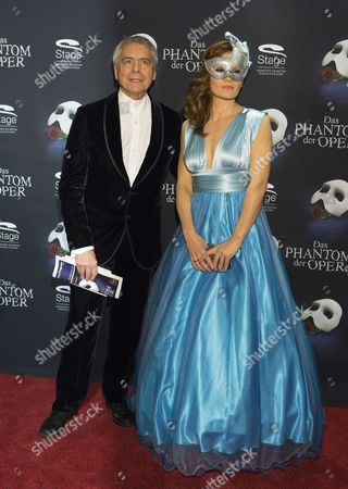Us Ballet Director John Neumeier and German Boxer Ina Menzer Pose on the Red Carpet Outside of the Neue Flora Theater Prior the Media Premiere of the Musical 'Phantom of the Opera' by British Composer Andrew Lloyd Webber in Hamburg ágermany 28ánovember 2013 the Musical was Staged From 1990 to 2001 and Now Has Returned to Hamburg For Ten Months Germany Hamburg