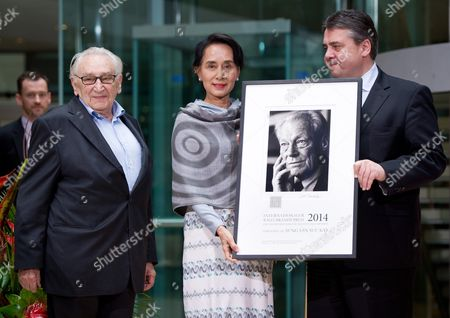 Stock Photo of Myanmar Opposition Leader Aung San Suu Kyi is Awarded the International Willy-brandt Prize by German Minister of Economics Sigmar Gabriel (r) and Spd Politician Egon Bahr (l) at the Willy-brandt-haus in Berlin Germany 11 April 2014 Aung San Suu Kyi was Awarded the International Willy-brandt Prize Germany Berlin