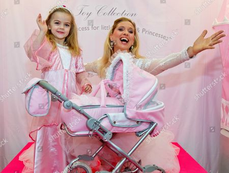 Princess Maja Synke of Hohenzollern (r) Unveils Her 2013 Toy Collection 'A Princess World' by Knorrtoys with Young Emma During the Show of New Products at the 64th International Toy Fair in Nuremberg Germany 29 January 2013 Germany Nuremberg