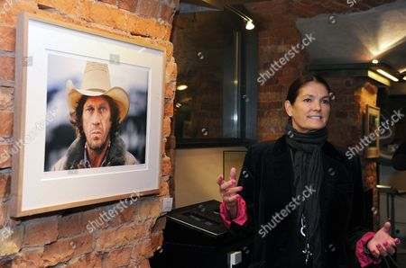 Barbara Mcqueen Widow of Us Actor Steve Mcqueen (1930-1980) Stands Gestures to One of Her Favorite Pictures Entitled 'Intense Cowboy' From 1978 During the Exhibition 'Steve Mcqueen - the Last Mile' at the Automobile Museum Prototyp in Hamburg Germany 26 September 2012 the Exhibition Presents Personal Photographs of the Actor by Barbara Mcqueen Until 30 December Germany Hamburg