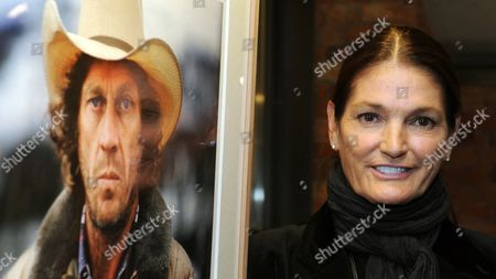 Barbara Mcqueen Widow of Us Actor Steve Mcqueen (1930-1980) Stands Next to One of Her Favorite Pictures Entitled 'Intense Cowboy' From 1978 During the Exhibition 'Steve Mcqueen - the Last Mile' at the Automobile Museum Prototyp in Hamburg Germany 26 September 2012 the Exhibition Presents Personal Photographs of the Actor by Barbara Mcqueen Until 30 December Germany Hamburg