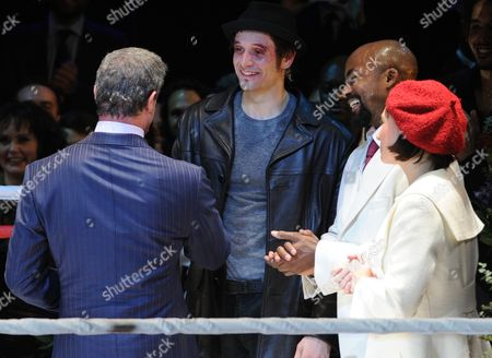 Stock Image of Us Actor Sylvester Stallone (l) Congratulates Us Actors Drew Sarich (2-l) Terence Archie (2-r) and Dutch Actress Wietske Van Tongeren (r) on Stage After the Premiere of the Musical 'Rocky' at the Tui Opera House in Hamburg Germany 18 November 2012 Germany Hamburg