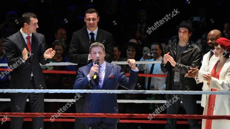 Stock Photo of Us Actor Sylvester Stallone (c) Boxers Vitali (2-l) and Vladimir Klitschko (l) and Us Actors Drew Sarich (3-r) Terence Archie (as Apollo) and Dutch Actress Wietske Van Tongeren (as Adrian) on Stage After the Premiere of the Musical 'Rocky' at the Tui Opera House in Hamburg Germany 18 November 2012 Germany Hamburg