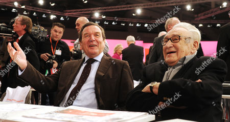 Former German Chancellor Gerhard Schroeder (left) and Veteran Party Member Egon Bahr Seated Beside Each Other As the Attend the Extraordinary Social Democratic Party Congress in Hannover 9 December 2012 Germany Hannover