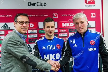 Nuremberg's Sports Director Martin Bader (l-r) Shakes Hands with the New Coaches of the German Bundesliga Soccer Club 1 Fc Nuremberg Michael Wiesinger and Armin Reutershahn at a Press Conference in Nuremberg Germany 03 January 2013 Germany Nuremberg