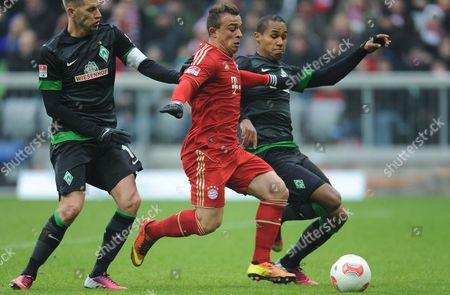 Munich's Xherdan Shaqiri (m) and Aaron Hunt (l) As Well As Theodor Gebre Selassie of Bremen Fight For the Ball During the Bundesliga Soccer Match Between Fc Bayern Munich and Sv Werder Bremen at Allianz Arena in Munich Germany 23 February 2013 (attention: Embargo Conditions! the Dfl Permits the Further Utilisation of Up to 15 Pictures Only (no Sequntial Pictures Or Video-similar Series of Pictures Allowed) Via the Internet and Online Media During the Match (including Halftime) Taken From Inside the Stadium And/or Prior to the Start of the Match the Dfl Permits the Unrestricted Transmission of Digitised Recordings During the Match Exclusively For Internal Editorial Processing Only (e G Via Picture Picture Databases) ) Epa/andreas Gebert Germany Munich
