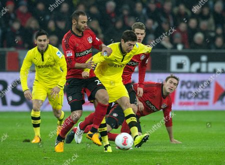 Dortmund's Robert Lewandowski (m) Vies For the Ball with Leverkusen's Omer Toprak (2-l) and Lars Bender (2-r) During the German Bundesliga Soccer Match Between Bayer Leverkusen and Borussia Dortmund at Bayarena in Leverkusen Germany 03 February 2013 (attention: Embargo Conditions! the Dfl Permits the Further Utilisation of Up to 15 Pictures Only (no Sequential Pictures Or Video-similar Series of Pictures Allowed) Via the Internet and Online Media During the Match (including Halftime) Taken From Inside the Stadium And/or Prior to the Start of the Match the Dfl Permits the Unrestricted Transmission of Digitised Recordings During the Match Exclusively For Internal Editorial Processing Only (e G Via Picture Databases) ) Germany Leverkusen
