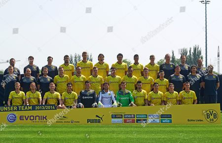 Borussia Dortmund Players and Coaching Staff Pose For Photographers During Their Team's Presentation at the German Bundesliga Soccer Club's Premises in Dortmund Germany 09 July 2013 Front Row (l-r): Oliver Kirch Marcel Schmelzer Jakub Blaszcykowski Nuri Sahin Goalkeepers Zlatan Alomerovic Roman Weidenfeller and Mitch Langerak Ilkay Guendogan Koray Guenter Jonas Hofmann and Sebastian Kehl; Middle Row (l-r): Peter Kuhnt Thomas Zetzmann Thorben Voeste (all Physiotherapists) Kevin Grosskreutz Julian Schieber Marvin Ducksch Robert Lewandowski Pierre-emerick Aubameyang Marco Reus Henrikh Mkhitaryan Assistant Coaches Peter Krawirtz and Zeljko Buvac and Head Coach Jurgen Klopp ; Back Row (l-r): Andreas Schlumberger Andreas Beck Florian Wangler (all Athletics Coaches) Sokratis Papastathopoulos Lasse Sobiech Neven Subotic Mats Hummels Marian Sarr Sven Bender Kit Manager Frank Graefen Team Physician Markus Braun and Goalkeeper Coach Teddy De Beer Germany Dortmund