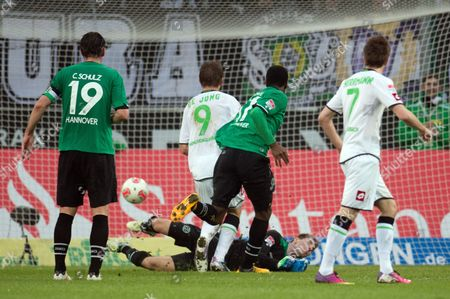 Mönchengladbach's Luuk De Jong (c) Scores the 1-0 Goal Against Hanover's Christian Schulz Goal Keeper Ron-robert Zieler and Didier Ya Konan During the Bundesliga Game Borussia Mönchengladbach Vs Hannover 96 at Borussia Park in Mönchengladbach Germany 17 March 2013 (attention: Embargo Conditions! the Dfl Permits the Further Utilisation of Up to 15 Pictures Only (no Sequntial Pictures Or Video-similar Series of Pictures Allowed) Via the Internet and Online Media During the Match (including Halftime) Taken From Inside the Stadium And/or Prior to the Start of the Match the Dfl Permits the Unrestricted Transmission of Digitised Recordings During the Match Exclusively For Internal Editorial Processing Only (e G Via Picture Databases) Germany Moenchengladbach