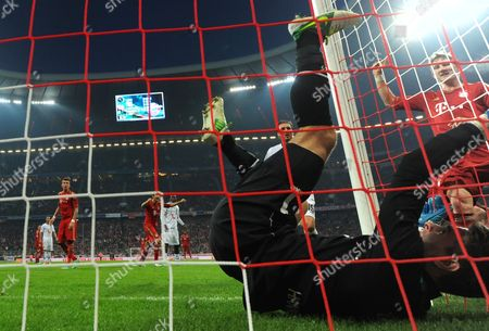 Munich's Bastian Schweinsteiger (r) Celebrates Dante's 4-0 Goal Next to Hannover's Goalkeeper Ron-robert Zieler During the German Bundesliga Match Between Fc Bayern Munich and Hannover 96 at Allianz Arena in Munich Germany 24 November 2012 (attention: Embargo Conditions! the Dfl Permits the Further Utilisation of Up to 15 Pictures Only (no Sequntial Pictures Or Video-similar Series of Pictures Allowed) Via the Internet and Online Media During the Match (including Halftime) Taken From Inside the Stadium And/or Prior to the Start of the Match the Dfl Permits the Unrestricted Transmission of Digitised Recordings During the Match Exclusively For Internal Editorial Processing Only (e G Via Picture Picture Databases) Germany Munich