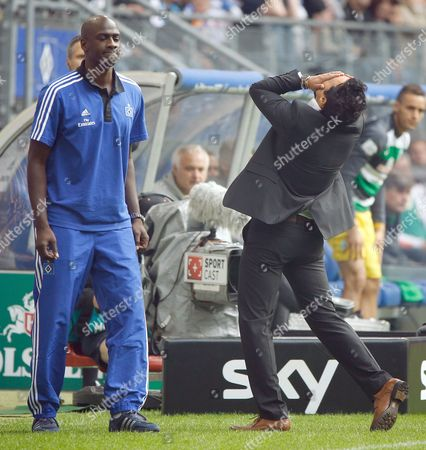 Stock Image of Hamburg's Interim Head Coaches Otto Addo (l) and Rodolfo Cardoso React to Events of the Bundesliga Soccer Match Between Hamburger Sv and Werder Bremen at Imtech-arena in Hamburg Germany 21 September 2013 (attention: Due to the Accreditation Guidelines the Dfl Only Permits the Publication and Utilisation of Up to 15 Pictures Per Match on the Internet and in Online Media During the Match ) Germany Hamburg