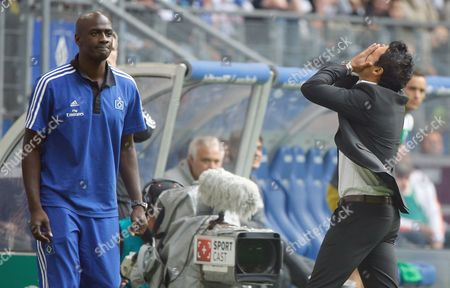 Hamburg's Interim Head Coaches Otto Addo (l) and Rodolfo Cardoso React to Events of the Bundesliga Soccer Match Between Hamburger Sv and Werder Bremen at Imtech-arena in Hamburg Germany 21 September 2013 (attention: Due to the Accreditation Guidelines the Dfl Only Permits the Publication and Utilisation of Up to 15 Pictures Per Match on the Internet and in Online Media During the Match ) Germany Hamburg
