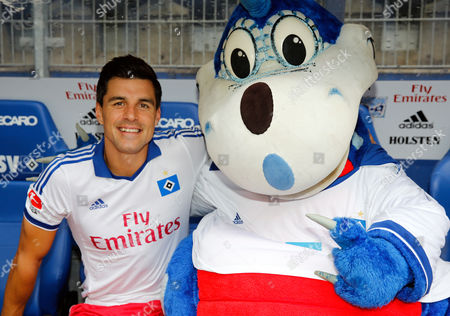 Hamburger Sv's Paul Scharner From Austria Poses with Team Mascot Dino Hermann During the Official Team Photo Session For the 2013/14 Season at Imtech Arena in Hamburg Germany 30 July 2013 Germany Hamburg