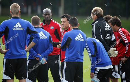 Sv Hamburg's Reserve Team Coach Rodolfo Cardoso (4-l) and Junior Team Coach Otto Addo (3-l) Lead a Training Session at the Imtech-arena in Hamburg Germany 17 September 2013 Troubled Sv Hamburg Have Parted Company with Coach Thorsten Fink in the Wake of Poor Results the Bundesliga Club Confirmed on 17 September Cardoso and Addo Will Act As Caretakers Until a New Coach Has Been Found Germany Hamburg