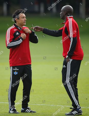 Stock Picture of Sv Hamburg's Reserve Team Coach Rodolfo Cardoso (l) and Junior Team Coach Otto Addo Lead a Training Session at the Imtech-arena in Hamburg Germany 17 September 2013 Troubled Sv Hamburg Have Parted Company with Coach Thorsten Fink in the Wake of Poor Results the Bundesliga Club Confirmed on 17 September Cardoso and Addo Will Act As Caretakers Until a New Coach Has Been Found Germany Hamburg