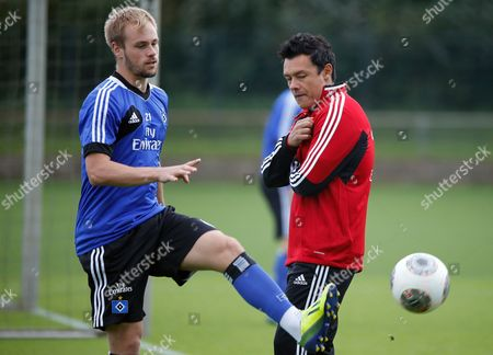 Sv Hamburg's Reserve Team Coach Rodolfo Cardoso Watches Player Maximilian Beister (l) During a Training Session at the Imtech-arena in Hamburg Germany 17 September 2013 Troubled Sv Hamburg Have Parted Company with Coach Thorsten Fink in the Wake of Poor Results the Bundesliga Club Confirmed on 17 September Cardoso and Junior Team Coach Otto Addo Will Act As Caretakers Until a New Coach Has Been Found Germany Hamburg