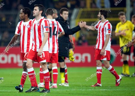 Olympiacos' Jean Makoun Pablo Orbaiz Kevin Mirallas and Djamel Abdoun (l-r) Leave the Pitch After the Uefa Champions League Group F Soccer Match Between Borussia Dortmund and Olympiacos Piraeus at the Signal-iduna-park Stadium in Dortmund Germany 01 November 2011 Germany Dortmund