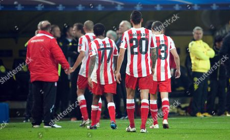 Olympiacos' Jean Makoun Jose Holebas and Djamel Abdoun (l-r) Leave the Pitch After the Uefa Champions League Group F Soccer Match Between Borussia Dortmund and Olympiacos Piraeus at the Signal-iduna-park Stadium in Dortmund Germany 1 November 2011 Germany Dortmund