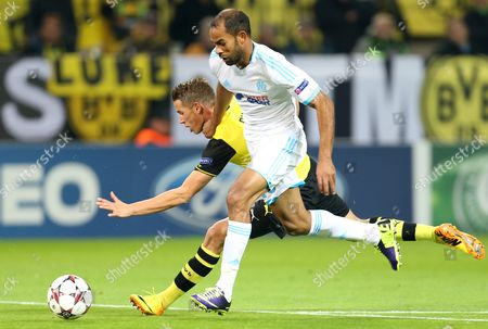 Dortmund;s Eric Durm (l) and Marseille's Saber Khalifa (r) in Action During Uefa Champions League Group F Match Between Borussia Dortmund and Olympique Marseille in Dortmund Germany 01 October 2013 Germany Dortmund