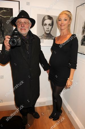 Barry Lategan with Tamara Beckwith in front of his portrait of Twiggy