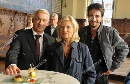 German Actors Oliver Mommsen (r) As Chief Inspector Stedefreund Sabine Postel As Chief Inspector Inga Luersen and Christoph M Orth (l) As Judge Konrad Bauser Pose For the Photographer During the Shooting of the 'Tatort' Tv-crime Thriller with the Working Title 'Puppeteer' at the City Hall in Bremen Germany 23 August 2012 Germany Bremen