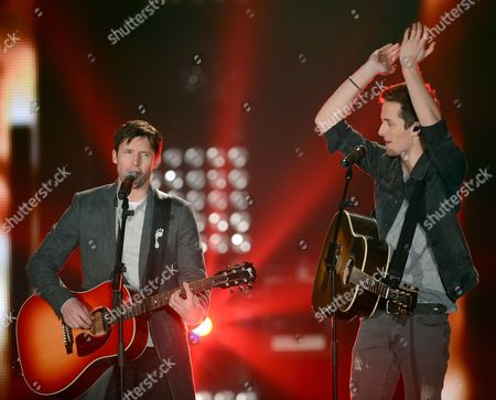 Stock Picture of Singer Chris Schummert (r) Performs Onstage with British Singer James Blunt (l) During the Final of the Reality Tv Casting Show 'The Voice of Germany' in Berlin Germany 20 December 2013 Germany Berlin