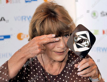 German Actress Hannelore Hoger Poses with the Grimme Award in the Category 'Special Award' in Marl Germany 23 March 2012 the Grimme Awards Were Given For the 48th Time This Year Germany Marl
