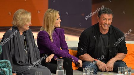 A Photo Made Available 06 October 2013 Shows Us Movie Star Sylvester Stallone (r) Along with German Singer Helene Fischer (c) and Actress Ruth Maria Kubitschek (l) Sitting on the Guests' Sofa During the German Television Show 'Wetten Dass ?' ('bet That ') in Bremen Germany 05 October 2013 Evening Germany Bremen