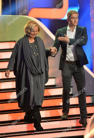 Stock Image of A Photo Made Available 06 October 2013 Shows Actors Matthias Schweighoefer (r) and Ruth Maria Kubitschek Appear on Stage During the German Television Show 'Wetten Dass ?' ('bet That ') in Bremen Germany 05 October 2013 Evening Germany Bremen